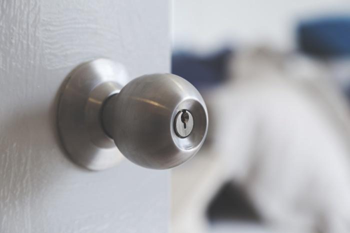 half opened bedroom door with door knob